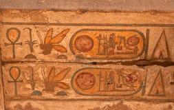 Egyptian hieroglyphics. Egyptian hieroglyph in the Medinet Habu temple near Luxor Thebes Stock Photo
