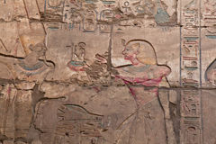 Egyptian hieroglyphics. Egyptian hieroglyph in the Medinet Habu temple near Luxor Thebes Royalty Free Stock Photos