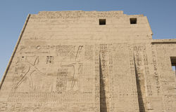 Egyptian hieroglyphics on a large temple wall Royalty Free Stock Photos