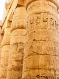Egyptian hieroglyphics on the stone column Royalty Free Stock Image