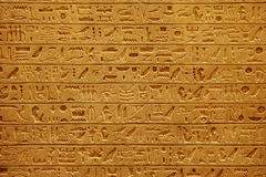Egyptian hieroglyphics. On the stone wall Stock Image