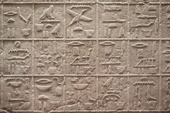 Egyptian hieroglyphics writing on stone Stock Photo