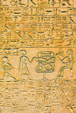 Egyptian hieroglyphs. Old grunge Egyptian wall with detailed texture Royalty Free Stock Photos