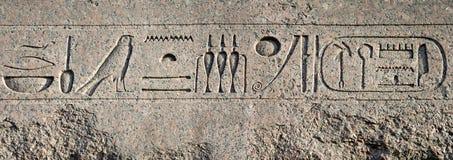Egyptian hieroglyphs. Granite wall with an Egyptian hieroglyphs Stock Photo