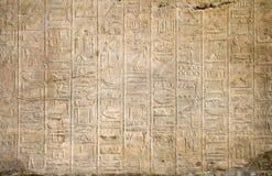 Egyptian hieroglyphs. Stone wall with an Egyptian hieroglyphs Royalty Free Stock Photos