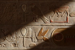 Egyptian Hieroglyphs. In the mortuary temple of Queen Hapshepsut at Deir el-Bahri on the western bank of the Nile near Luxor (Thebes Royalty Free Stock Images