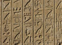 Egyptian hieroglyphs. Old egyptian hieroglyphs background. Karnak temple in Luxor, Thebes, Egypt, Africa Stock Images