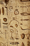 Egyptian hieroglyphs. Wall with egyptian hieroglyphics and symbols Royalty Free Stock Photography