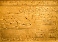Egyptian hieroglyphs carved on clay Royalty Free Stock Photo
