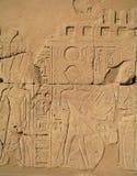 Egyptian  hieroglyphs engraved on stone Royalty Free Stock Photo