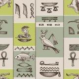Egyptian hieroglyphs. Geometric seamless pattern royalty free illustration