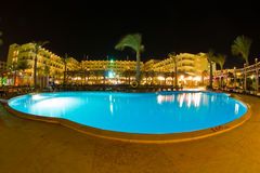 Egyptian hotel complex. Big hotel complex at night with illuminated swimming pool in the foreground, Hurghada, Egypt Royalty Free Stock Image