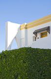 Egyptian hotel detail. Close up of Egyptian tourist hotel with hedge in foreground Royalty Free Stock Images