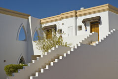 Egyptian hotel details. Exterior of Egyptian hotel showing white walled stairway Stock Photo