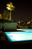 Egyptian Hotel Poolside. A view of the poolside of a Egyptian hotel at night in Sharm el Sheikh, Egypt Stock Photography