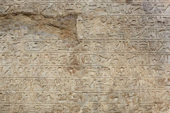 Egyptian hyerogliphs writing on old broken stone background Royalty Free Stock Photography