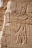 Egyptian images and hieroglyphs engraved on stone Stock Photography