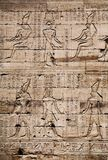 Egyptian images and hieroglyphs engraved on stone royalty free stock images