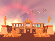 Egyptian Kingdom 01. A flock of Sacred Ibis birds fly over an Egyptian palace and its entrance lined with Ram God Khnum statues