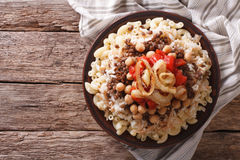 Egyptian kushari of rice, pasta, chickpeas and lentils horizonta Royalty Free Stock Photos