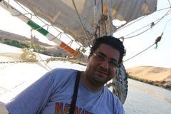 Egyptian man on boat stock image
