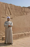 Egyptian Man guarding entrance to Philae Temple. An egyptian man guarding the entrance to a tomb in Philae - Egypt, 2008 Royalty Free Stock Images