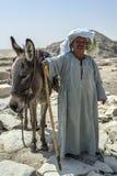 An Egyptian man and his donkey at Saqqara in Egypt. Royalty Free Stock Photos