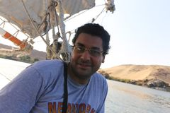 Egyptian Man On Boat Stock Photo