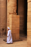 Egyptian man walking by the column, Philae Temple Stock Images