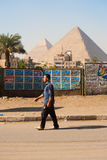 Egyptian Man Walking Giza Pyramids Stock Image