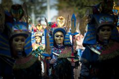 Egyptian masks. Badajoz, Spain - March 2, 2019: Performers with costumes inspired in Egyptian masks take part in the Carnival parade of comparsas at Badajoz City stock images