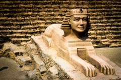 Egyptian model. Sand Sphinx statue with pyramid building Stock Photos