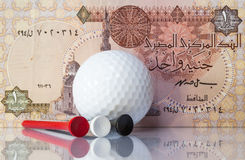 Egyptian money and golf equipments Stock Image