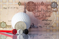 Egyptian money and golf equipments Stock Photos