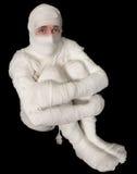 Egyptian mummy emo sitting on a black Royalty Free Stock Image