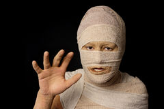 Egyptian mummy. Woman wrapped up with bandages as an egyptian mummy as halloween costume stock images
