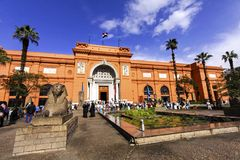 Egyptian Museum in Cairo. Tourist People and small Sphinx Statue in Courtyard Outside Famous Egyptian Museum on a sunny January day in Cairo stock images