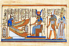 Egyptian papyrus. Isis and winged Maat together with Horus and Nefertari Royalty Free Stock Photo