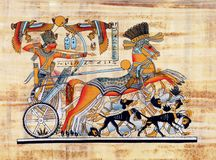 Egyptian papyrus. The king Tutankhamun is fighting the invaders of his country on his chariot Royalty Free Stock Photography