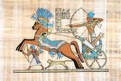 Egyptian papyrus. War Scene With Rameses Seated In His Chariot Stock Photos