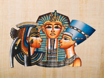 Egyptian papyrus. Showing Pharaoh Tutankhamen, Queen Nefertiti and Queen Cleopatra Stock Photography