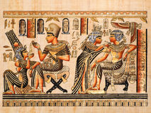 Egyptian papyrus. Showing both scenes of Tutankhamen and his wife Anhksenamon Royalty Free Stock Image