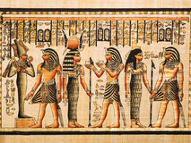 Egyptian papyrus. Showing the Pharaoh Tutankamen and gods Osiris, Hathor and Isis. Egypt series Royalty Free Stock Image