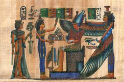 Egyptian papyrus with figures and signs. Isis and winged Maat together with Horus and Nefertari Royalty Free Stock Images