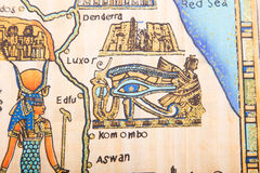 Egyptian Papyrus painting. Ancient Egyptian eye with Queen Cleopatra hand painting on papyrus Royalty Free Stock Photo