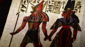 Egyptian papyrus with pharaohs and hieroglyphics representation. Of turning on black background