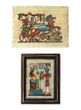 Egyptian Papyruses. Framed papyrus (Goddess Isis receiving flowers from a pharaoh) and unframed Egyptian papyrus (Ramses on a chariot in a battle Royalty Free Stock Photography