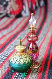 Egyptian perfume bottles. Arranged on a hand-woven Omani rug royalty free stock photo