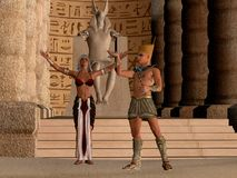 Egyptian Couple in Temple. The Egyptian Pharaoh and his wife worship and pray to their God called Anubis in their dynasty temple stock photo
