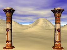 Egyptian pillars. Standing before sand dunes of the Sahara desert Royalty Free Stock Images